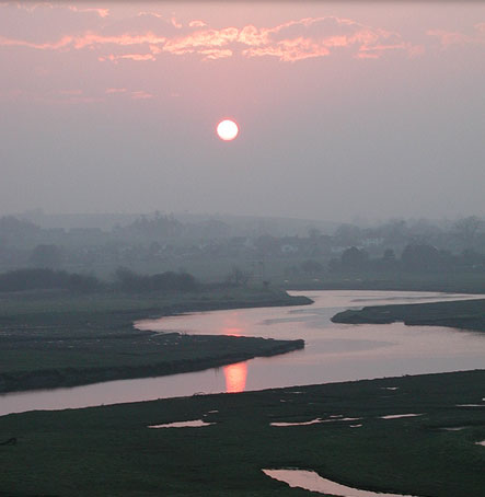 The Sun setting over the meandering River
